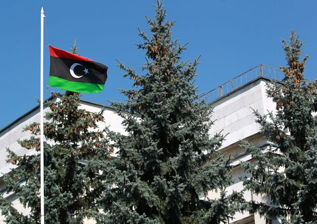 The flag of the National Transitional Council of Libya raised over the Libyan embassy in Moscow