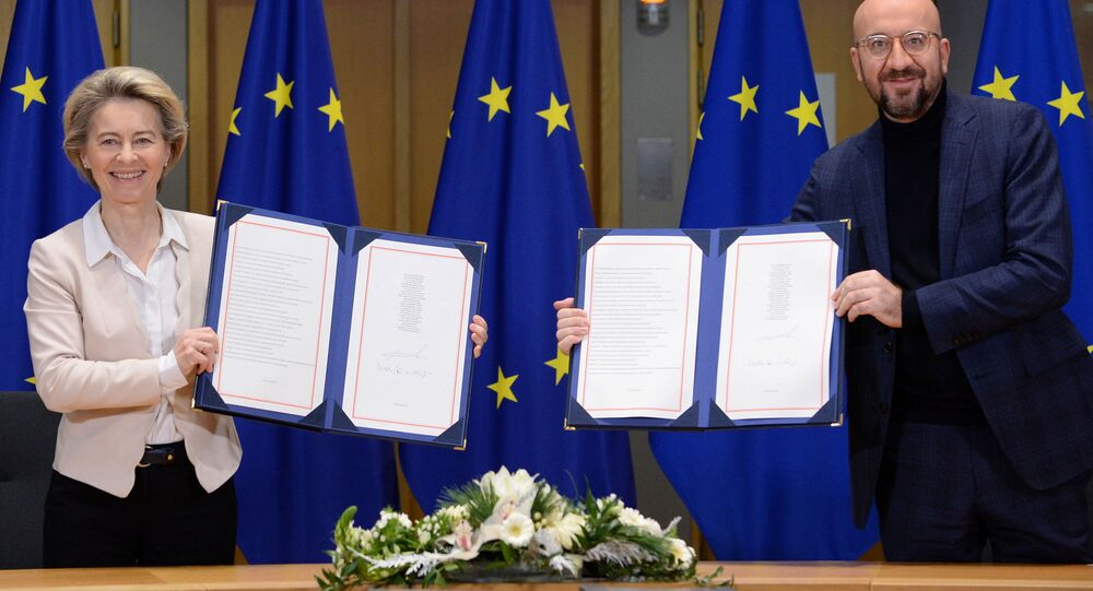 European Commission President Ursula von der Leyen and European Council President Charles Michel show signed Brexit trade agreement due to come into force on January 1, 2021, in Brussels, Belgium December 30, 2020