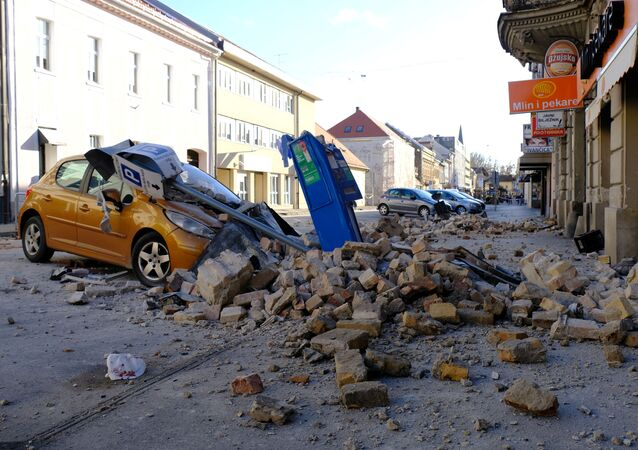 A destroyed car is seen on a street after an earthquake in Sisak, Croatia, 29 December 2020.