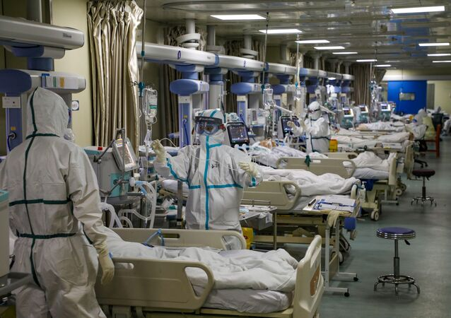 Medical workers in protective suits attend to novel coronavirus patients at the intensive care unit (ICU) of a designated hospital in Wuhan, Hubei Province, China, February 6, 2020.