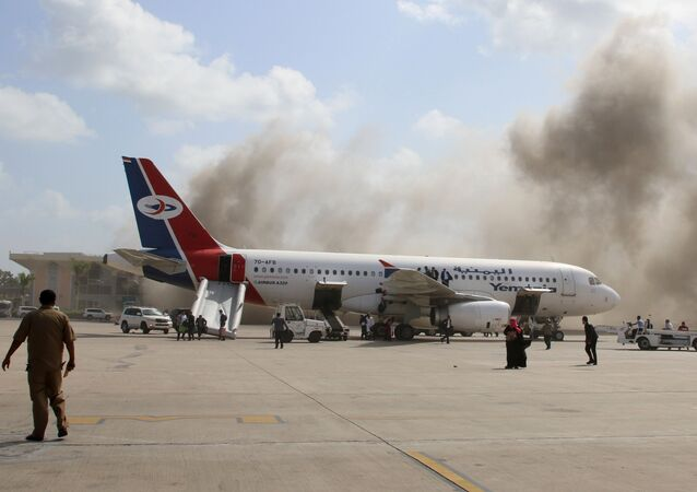 Dust rises after explosions hit Aden airport, upon the arrival of the newly-formed Yemeni government in Aden, Yemen December 30, 2020