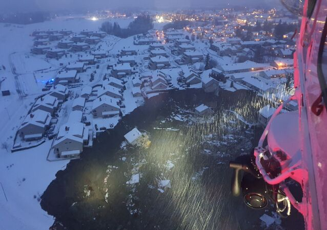 A rescue helicopter view shows the aftermath of a landslide at a residential area in Ask village, about 40km north of Oslo, Norway December 30, 2020