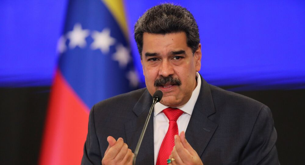 Venezuelan President Nicolas Maduro gestures as he speaks during a press conference following the ruling Socialist Party's victory in legislative elections that were boycotted by the opposition in Caracas, Venezuela December 8, 2020