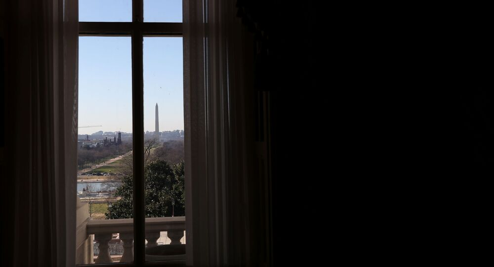 The Washington Monument can be seen through a window on the Senate side of the U.S. Capitol building before the House is expected to vote on increasing the second round of federal direct payments to $2,000 on Capitol Hill Washington, U.S., December 28, 2020.