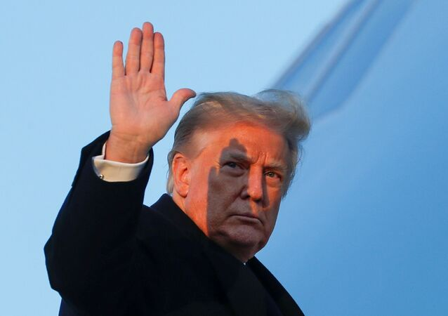 U.S. President Donald Trump waves as he boards Air Force One at Joint Base Andrews in Maryland, U.S., December 23, 2020