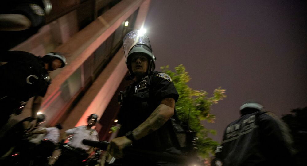 A NYPD policeman is seen during a protest against the death in Minneapolis police custody of George Floyd, in the Brooklyn borough of New York City, U.S., June 3, 2020.