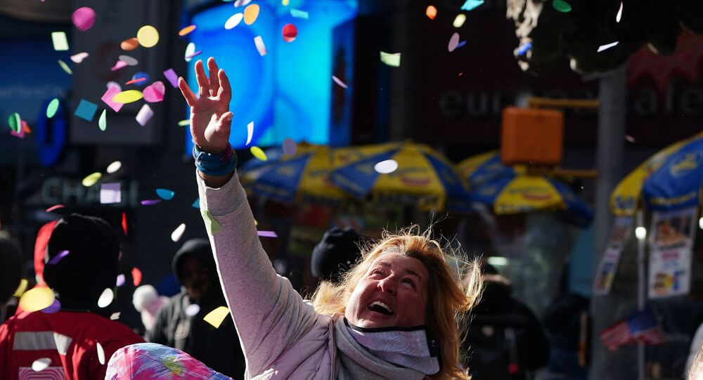 People try and catch some confetti at a 'flight test' ahead of the New Year's celebration in Times Square amid the coronavirus disease (COVID-19) pandemic in the Manhattan borough of New York City, New York, U.S., December 29, 2020.