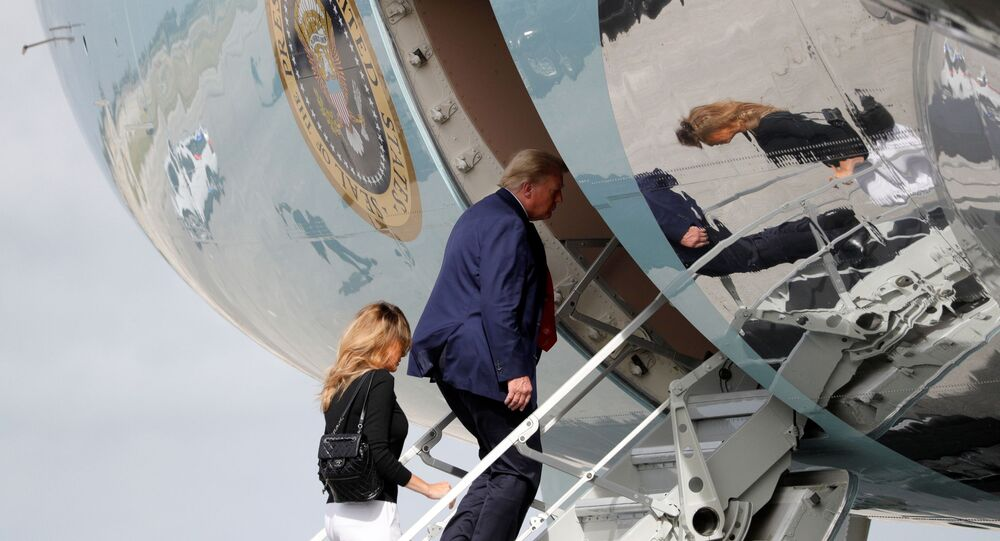 U.S. President Donald Trump boards Air Force One with first lady Melania Trump at Palm Beach International Airport in Florida, U.S., December 31, 2020