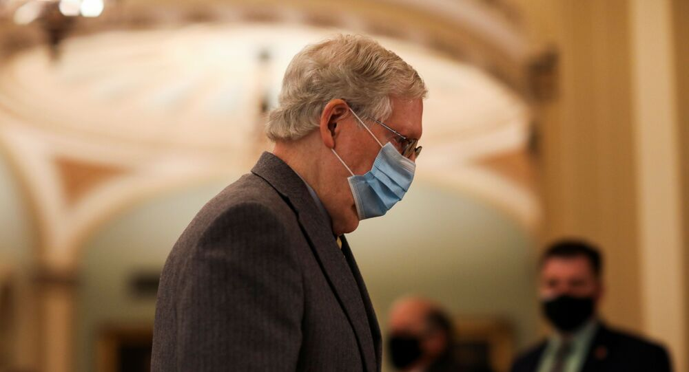 Senate Majority Leader Mitch McConnell leaves the Senate floor as he and the rest of the U.S. Senate face a decision over approving $2,000 stimulus checks on Capitol Hill in Washington, U.S., December 30, 2020.