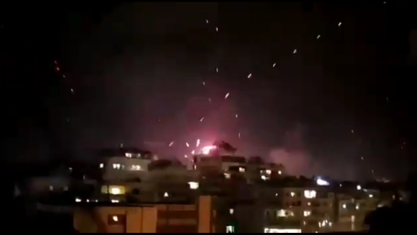 Fireworks and tracer rounds mix in the skies about Beirut, Lebanon, as revelers ring in the year 2021 just after midnight - Sputnik International