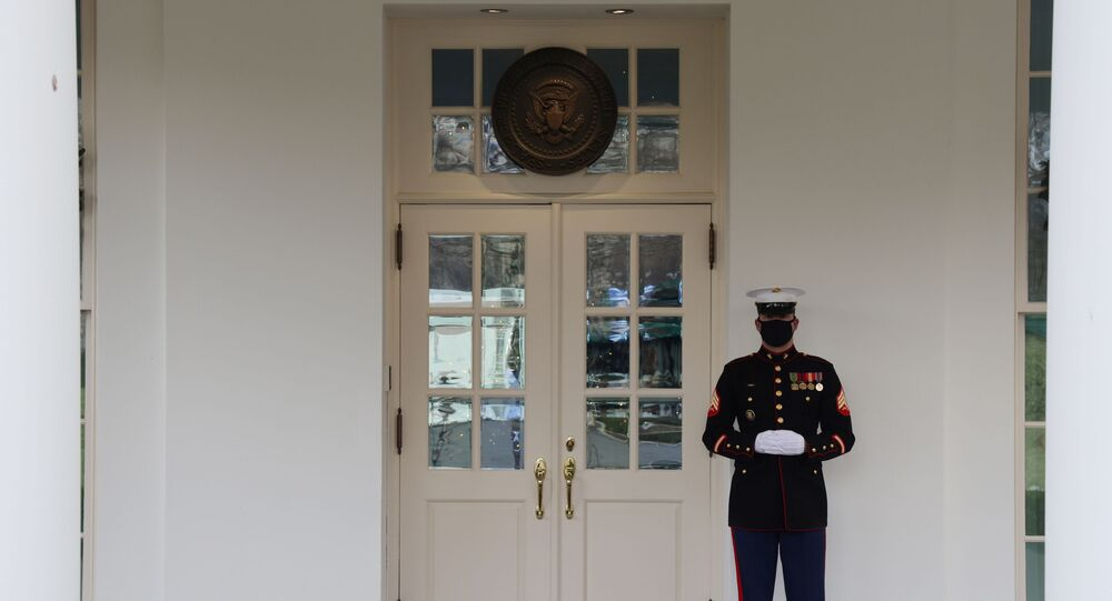 A general view of the door to the West Wing, where the presence of a US Marine is an indication that US President Donald Trump is present in the Oval Office, one of a combination of photos made once an hour during the president's ostensible workday at the White House on 22 December 2020