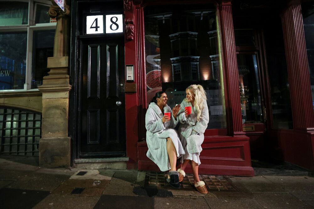 Two women celebrate New Year amid the outbreak of the coronavirus disease (COVID-19), in Newcastle, Britain 31 December 2020.