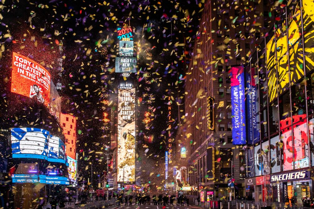 Confetti flies around the ball and countdown clock in Times Square during the virtual New Year's Eve event following the outbreak of the coronavirus disease (COVID-19) in the Manhattan borough of New York City, New York, US 1 January 2021.