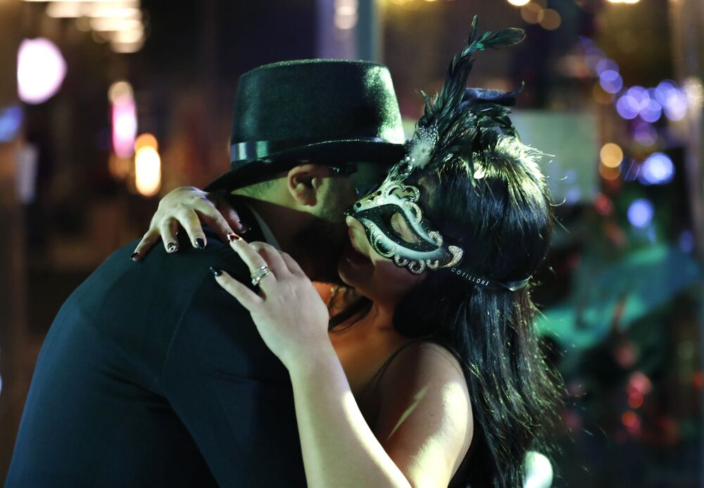 A Lebanese couple celebrate the New Year Eve at a restaurant in Beirut, Lebanon, early Friday, 1 January 2021. The Lebanese Health Minister appealed to revellers to keep their masks on and maintain social distance protocols.