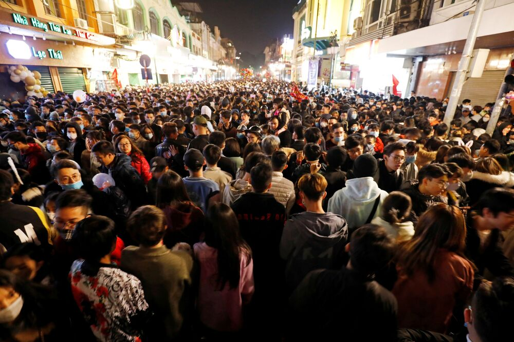 People gather on a street during New Year's Eve celebrations amid the coronavirus disease (COVID-19) pandemic, in Hanoi, Vietnam, 1 January 2021.