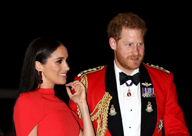 Britain's Prince Harry and his wife Meghan arrive to attend the Mountbatten Festival of Music at the Royal Albert Hall in London, Britain, 7 March 2020