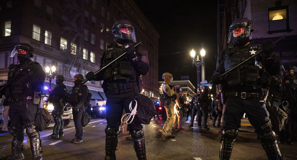 Police form a a perimeter during protests following the presidential election in Portland, Oregon, Wednesday, 4 November 2020