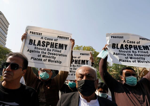 People from the Hindu community hold signs to condemn the attack on a century-old Hindu temple in northwestern Pakistan, during a protest outside Supreme Court building in Karachi, Pakistan December 31