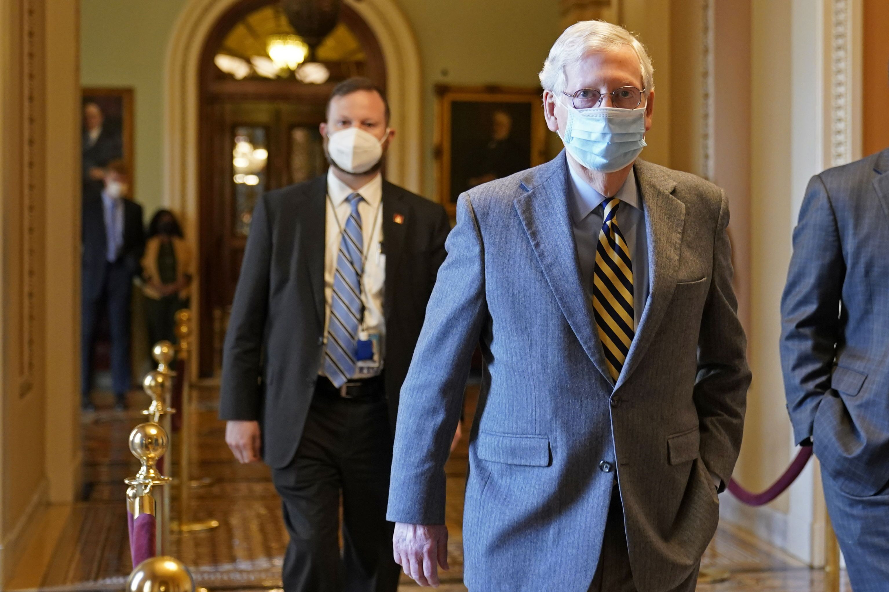 Senate Majority Leader Mitch McConnell of Ky., walks back to his office on Capitol Hill in Washington, Wednesday, Dec. 30, 2020