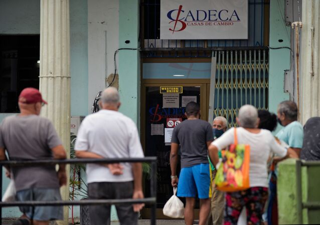 People queue at a Western Union office in Havana, as the US-based money transfer company shuts its officers in Cuba after new US sanctions, on November 23, 2020.