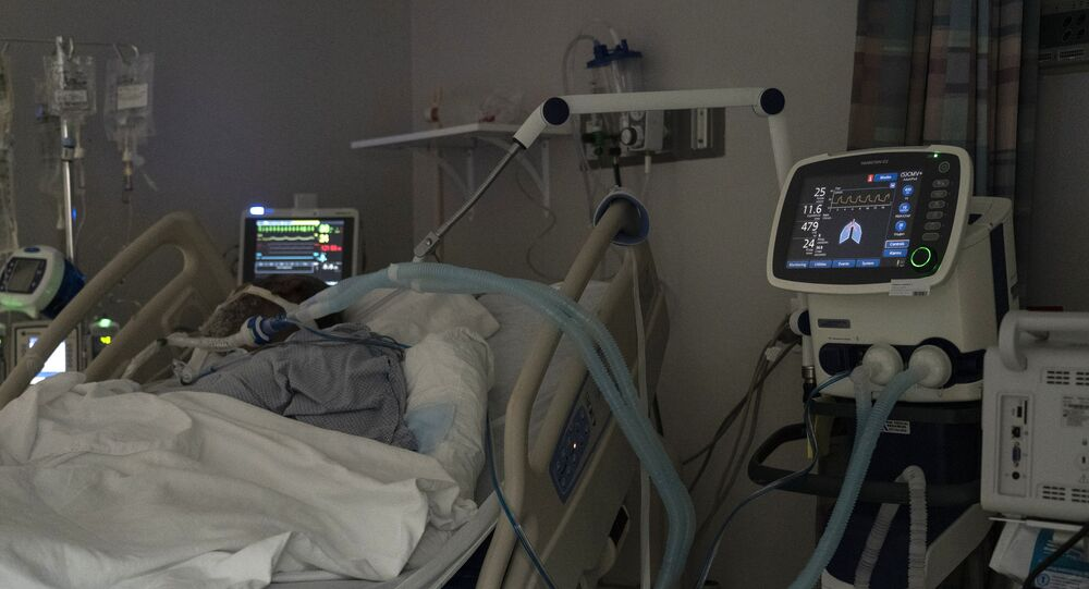 A patient is seen lying on a bed in the COVID-19 intensive care unit (ICU) on New Year's Day at the United Memorial Medical Center on January 1, 2021 in Houston, Texas.