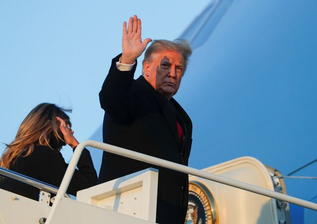 U.S. President Donald Trump waves as he boards Air Force One beside first lady Melania Trump at Joint Base Andrews in Maryland, U.S., December 23, 2020