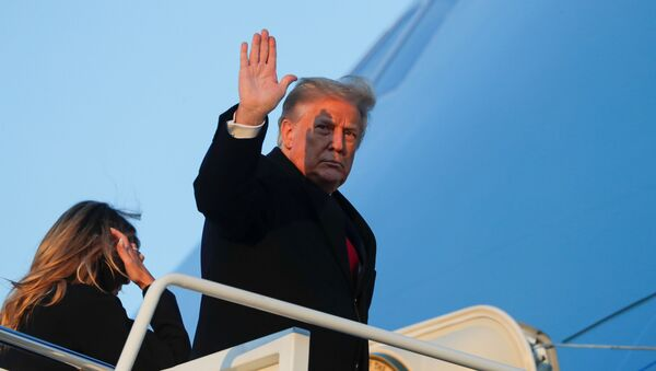 U.S. President Donald Trump waves as he boards Air Force One beside first lady Melania Trump at Joint Base Andrews in Maryland, U.S., December 23, 2020 - Sputnik International