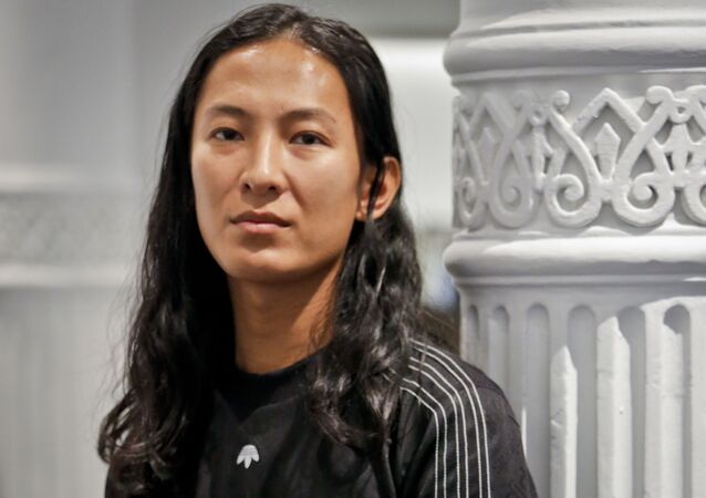 Fashion designer Alexander Wang poses in his studio Tuesday, Sept. 6, 2016, in New York. Wang will unveil his latest collection during Fashion Week, including his collaboration with Adidas-- adidas Originals by Alexander Wang,