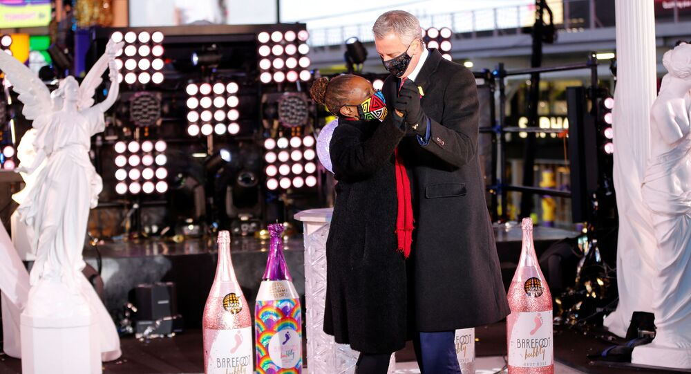 Mayor Bill De Blasio dances with his wife Chirlane McCray on New Years Day in Times Square in New York City, U.S., January 1, 2021.