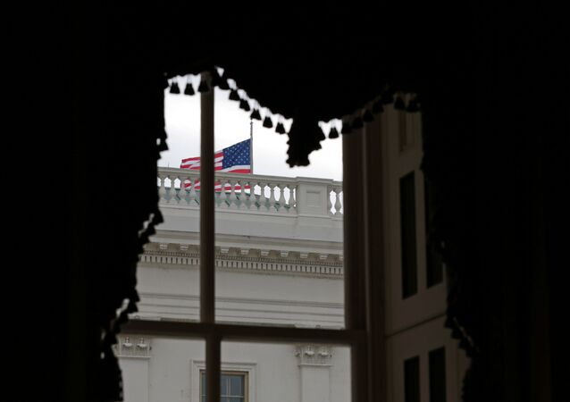 An American flag waves outside a window at the U.S. Capitol shortly before the Senate adjourns for the year, on Capitol Hill in Washington, U.S., December 31, 2020