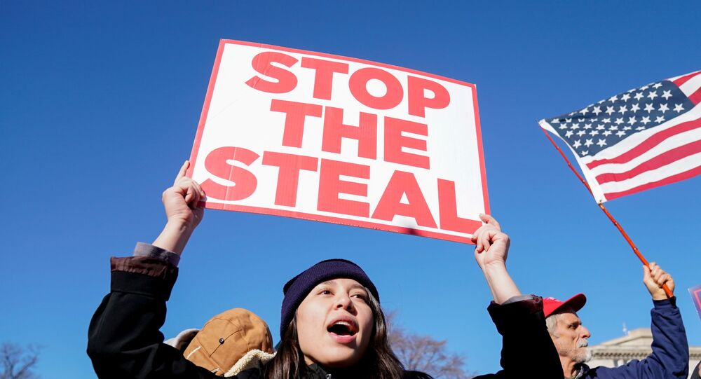 People participate in a Stop the Steal protest outside the U.S. Supreme Court in support of U.S. President Donald Trump in Washington, U.S., December 8, 2020.