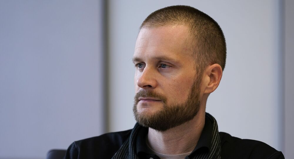 In this Dec. 31, 2020, file photo pardoned Blackwater contractor Evan Liberty poses for a photo in Washington. Liberty is one of four former Blackwater contractors pardoned by President Donald Trump in one of his final acts in office, wiping away their convictions in a 2007 shooting rampage in Baghdad that killed more than a dozen Iraqi civilians. The pardons were met with intense condemnation both in the United States and the Middle East.