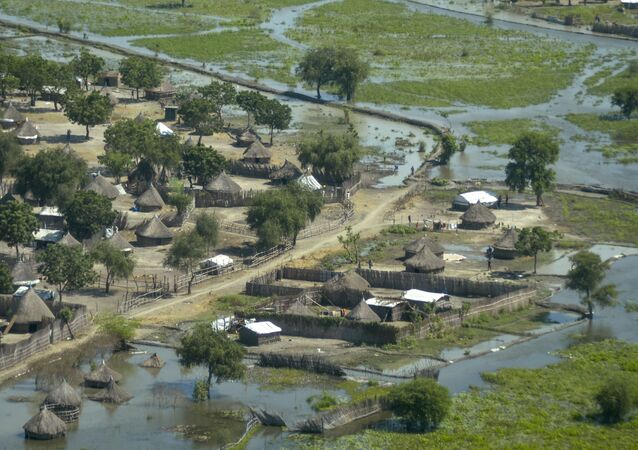Thatched huts surrounded by floodwaters are seen from the air in Old Fangak county, Jonglei state, South Sudan Friday, Nov. 27, 2020. Some 1 million people in the country have been displaced or isolated for months by the worst flooding in memory, with the intense rainy season a sign of climate change.
