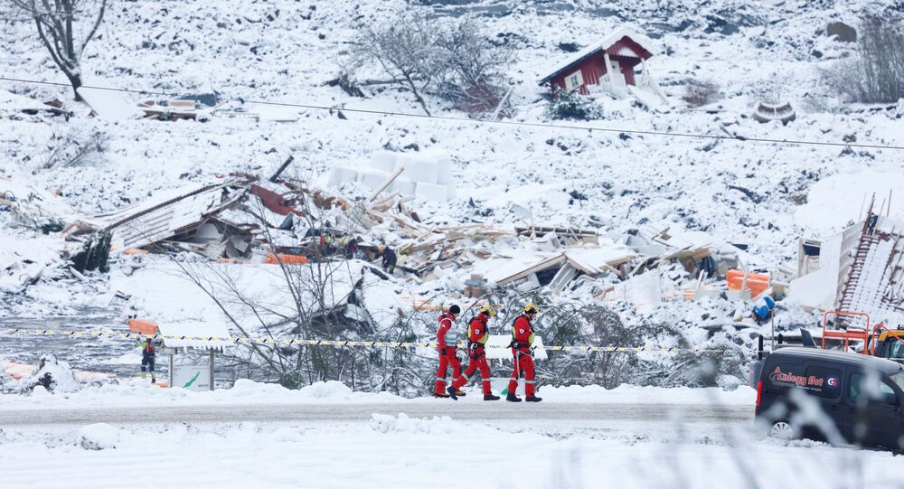 Debris from houses lies covered in snow as rescue crews work in the landslide area at Ask, Gjerdrum, Norway January 2, 2021