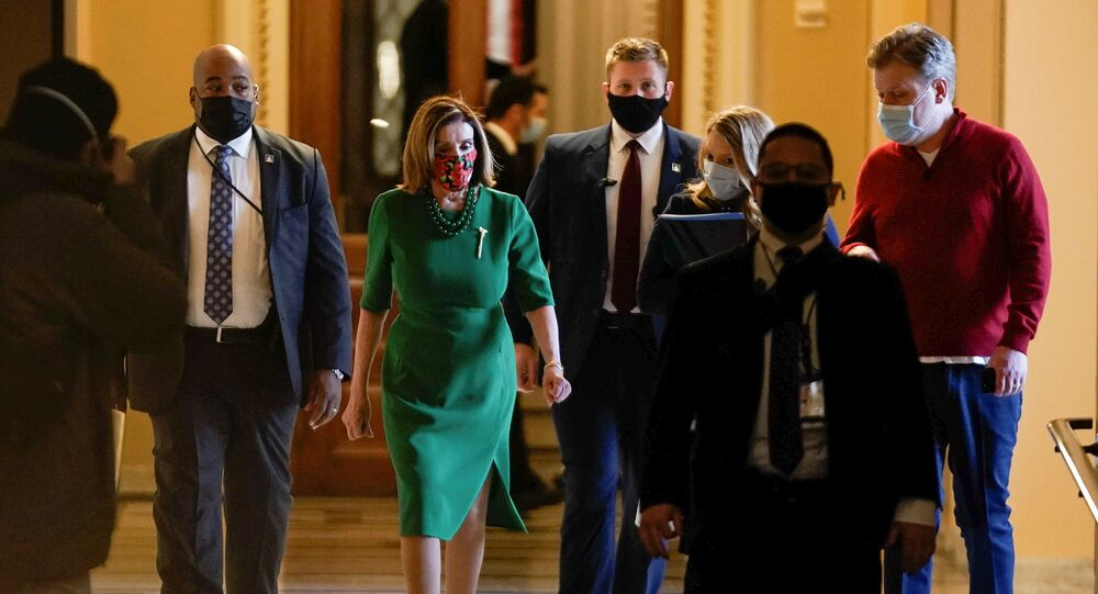 Speaker of the House Nancy Pelosi (D-CA) walks back to her office after opening the House floor following an agreement of a coronavirus disease (COVID-19) aid package the night before on Capitol Hill, Washington, D.C., U.S., December 21, 2020.