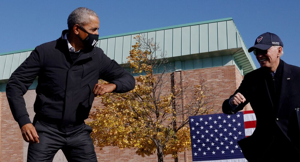 Democratic U.S. presidential nominee and former Vice President Joe Biden gestures with former U.S. President Barack Obama at a Get Out the Vote campaign stop in Flint, Michigan, U.S., October 31, 2020