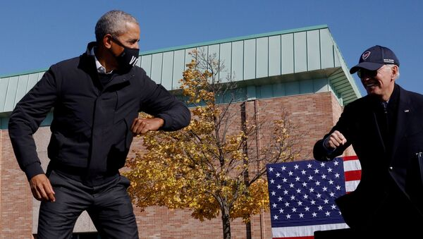 Democratic U.S. presidential nominee and former Vice President Joe Biden gestures with former U.S. President Barack Obama at a Get Out the Vote campaign stop in Flint, Michigan, U.S., October 31, 2020 - Sputnik International