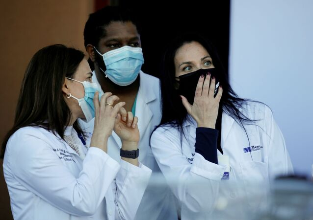 Health workers chat during a press conference before some workers of the staff receive the Pfizer-BioNTech COVID-19 Vaccine at Memorial Healthcare System facility in Miramar, Florida, U.S., December 14, 2020.