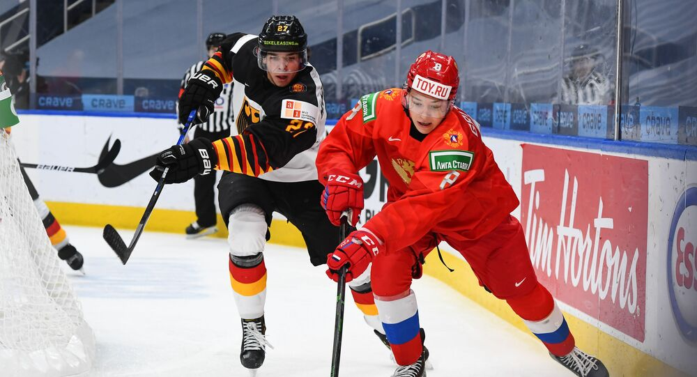 Russia's Arseni Gritsyuk #8 stickhandles the puck against Germany's Jan Munzenberger #27 in quarterfinal round action at the 2021 IIHF World Junior Championship at Rogers Place on January 2, 2021 in Edmonton, AB Canada.