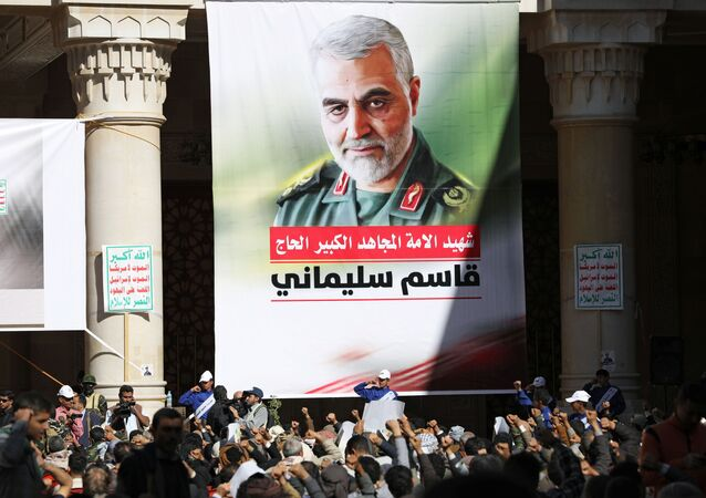 People attend a vigil marking the one year anniversary of the killing of Iranian military commander General Qassem Soleimani and Iraqi militia commander Abu Mahdi al-Muhandis in a U.S. drone attack, in Sanaa, Yemen January 2, 2021.