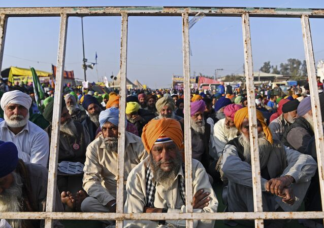 Farmers take part in a demonstration against the central government's recent agricultural reforms while blocking a highway at the Delhi-Haryana state border in Singhu on December 29, 2020.