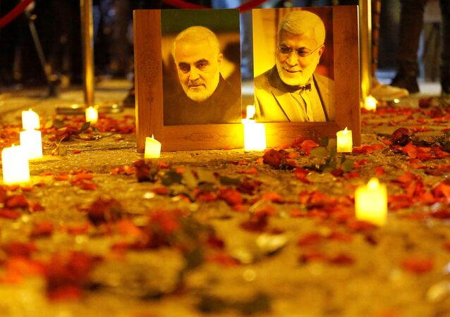 Flowers are laid near pictures of senior Iranian military commander General Qassem Soleimani and Iraqi militia commander Abu Mahdi al-Muhandis on the first anniversary of their killings in a U.S. attack, in Baghdad, Iraq, January 2, 2021.