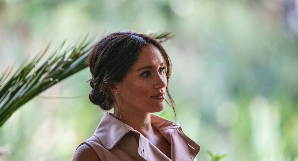 Meghan, the Duchess of Sussex arrives at the British High Commissioner residency where she  will meet with Graca Machel, widow of former South African president Nelson Mandela, in Johannesburg, on October 2, 2019.