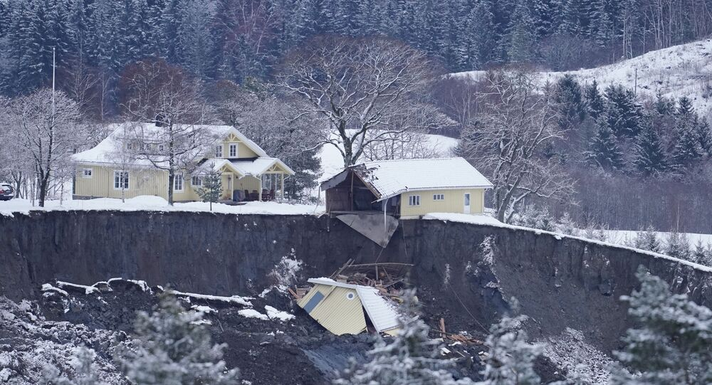 A view of destroyed homes after yesterday's landslide in Ask