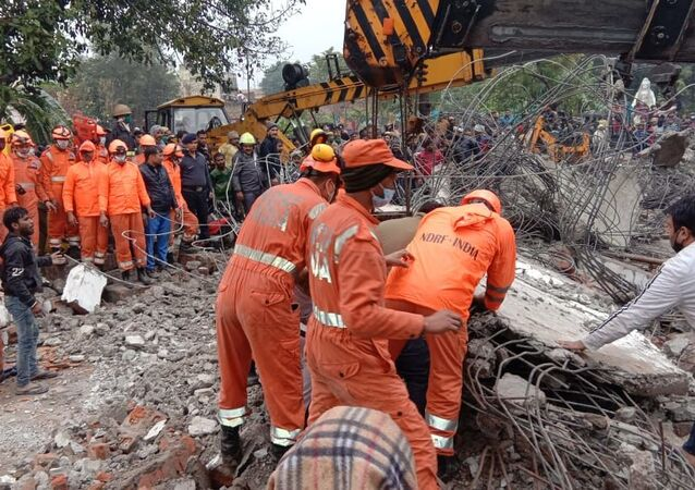 India's National Disaster Response Force conducts a rescue operation at a crematorium in Uttar Pradesh