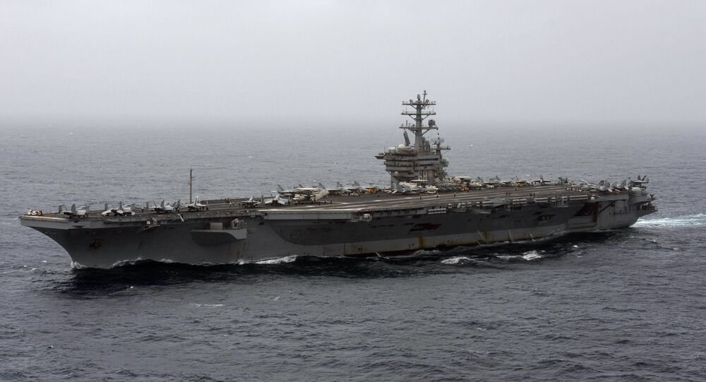 In this Sept. 7, 2020, file photo released by the U.S. Navy, the aircraft carrier USS Nimitz transits the Arabian Sea. The Pentagon announced Thursday, Dec. 31, 2020, that the USS Nimitz, the only Navy aircraft carrier operating in the Middle East, will return home to the U.S. West Coast.
