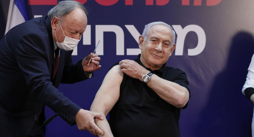 Israeli Prime Minister Benjamin Netanyahu receives a coronavirus vaccine at the Sheba Medical Center, the country's largest hospital, in Ramat Gan near the coastal city of Tel Aviv, on December 19, 2020.