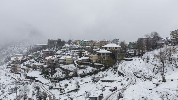 A view of Naddi village covered in snow is pictured in Dharamshala on December 14, 2019.  - Sputnik International