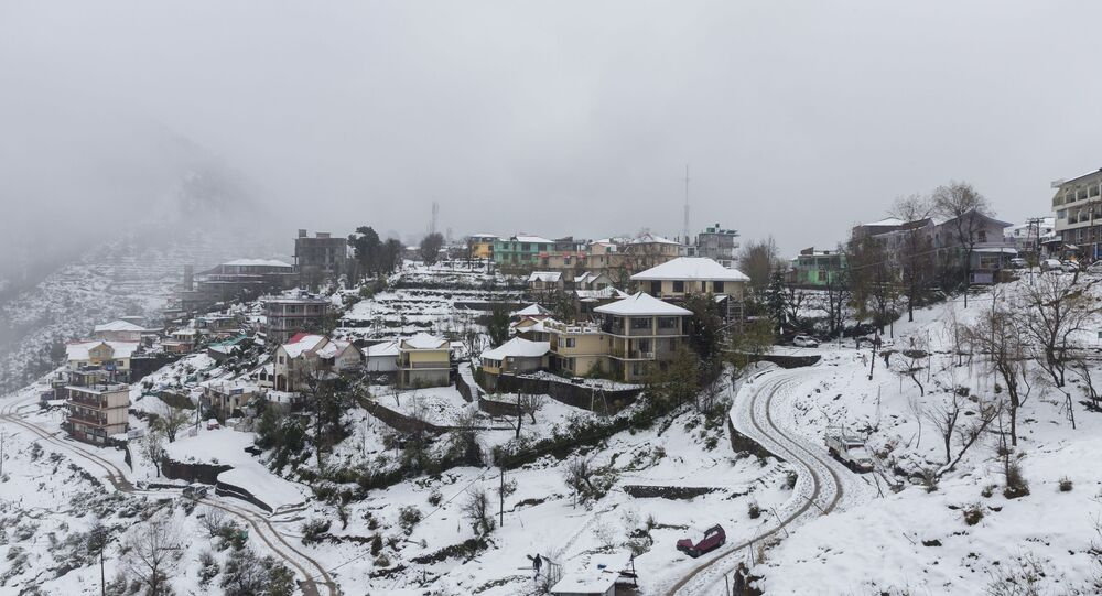 A view of Naddi village covered in snow is pictured in Dharamshala on December 14, 2019.