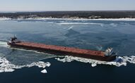 The 1,000-foot freighter Stewart J. Cort moves up the St Mary's River, between Lake Superior and Lake Huron, in March 2011